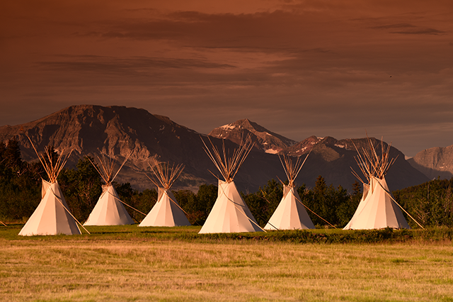 Teepees with mountains in the background