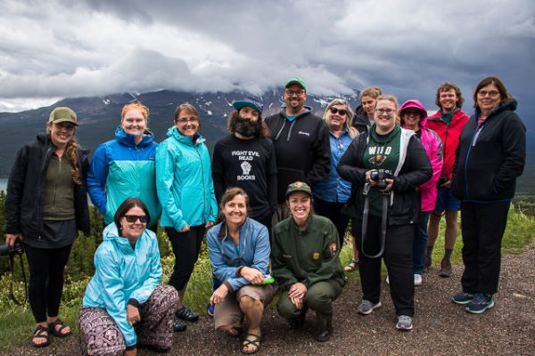 Teachers standing in front of mountain.