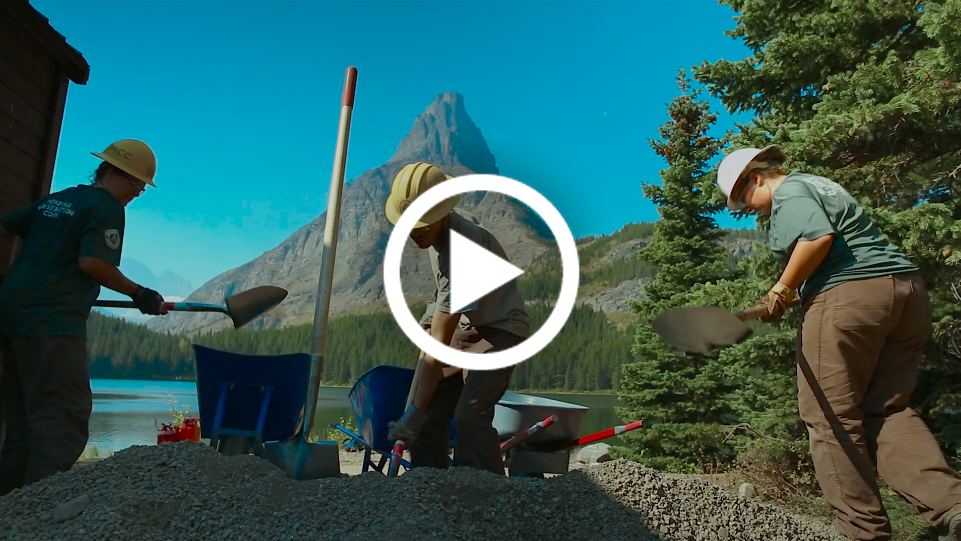A video still of a Montana Conservation Corps crew hard at work in Glacier National Park