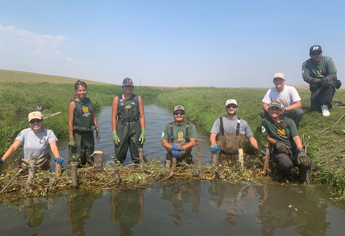 The Piikani Lands Crew building a beaver dam in East Glacier