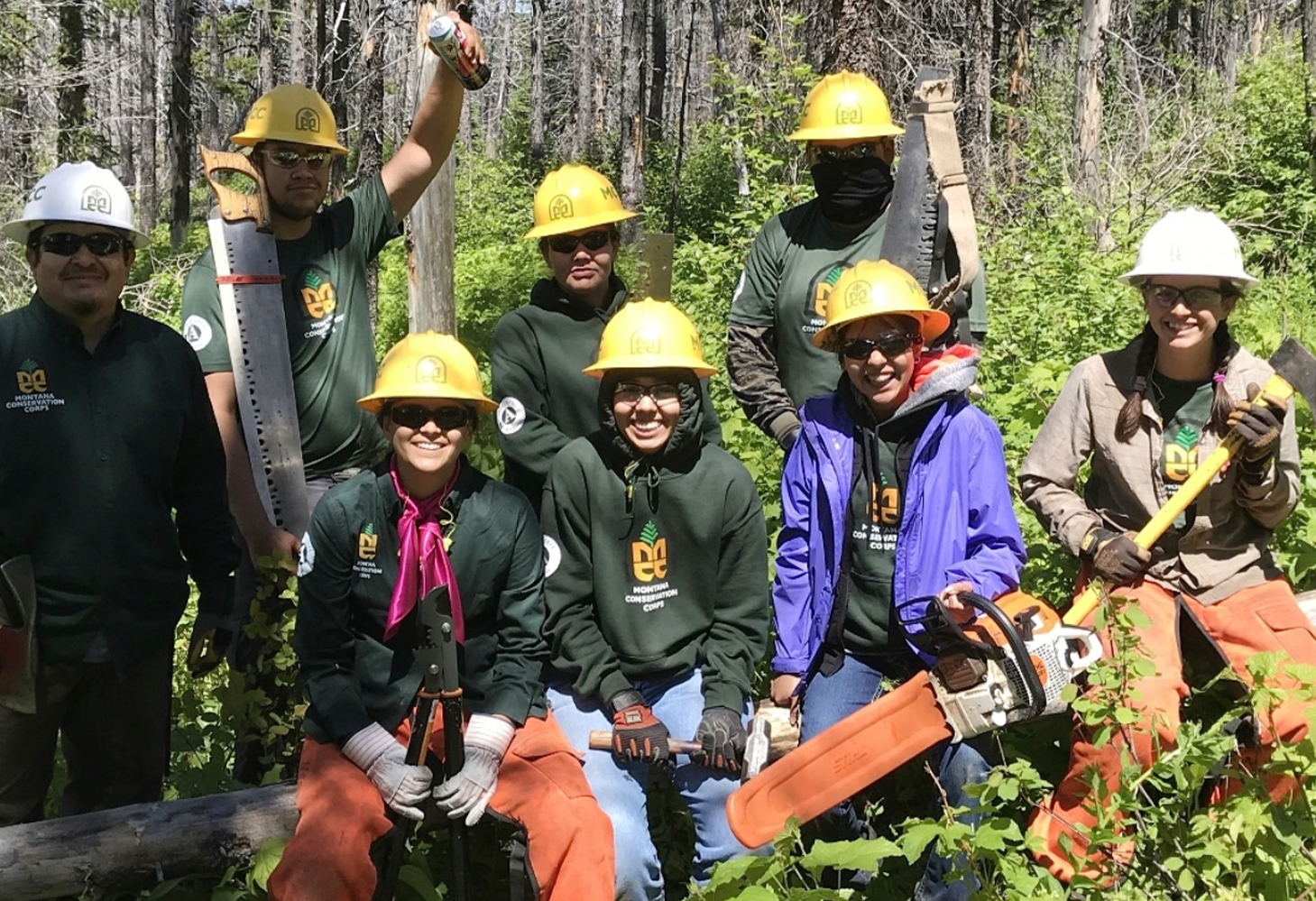 The Piikani Lands Crew fuels reduction team poses for a photo in the forest