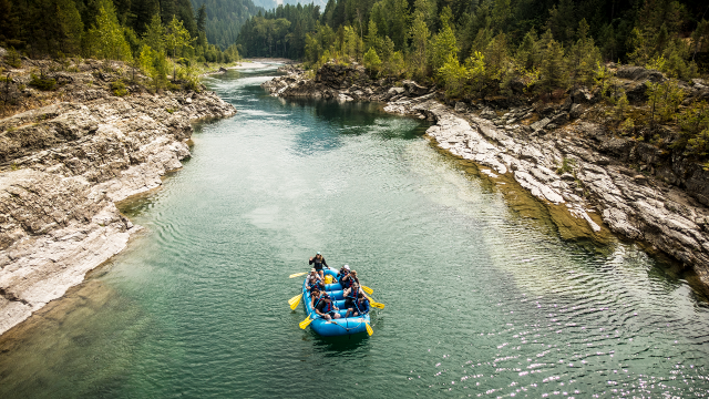 A group of rafters float down the Middle Fork of the Flathead River in Glacier National Park