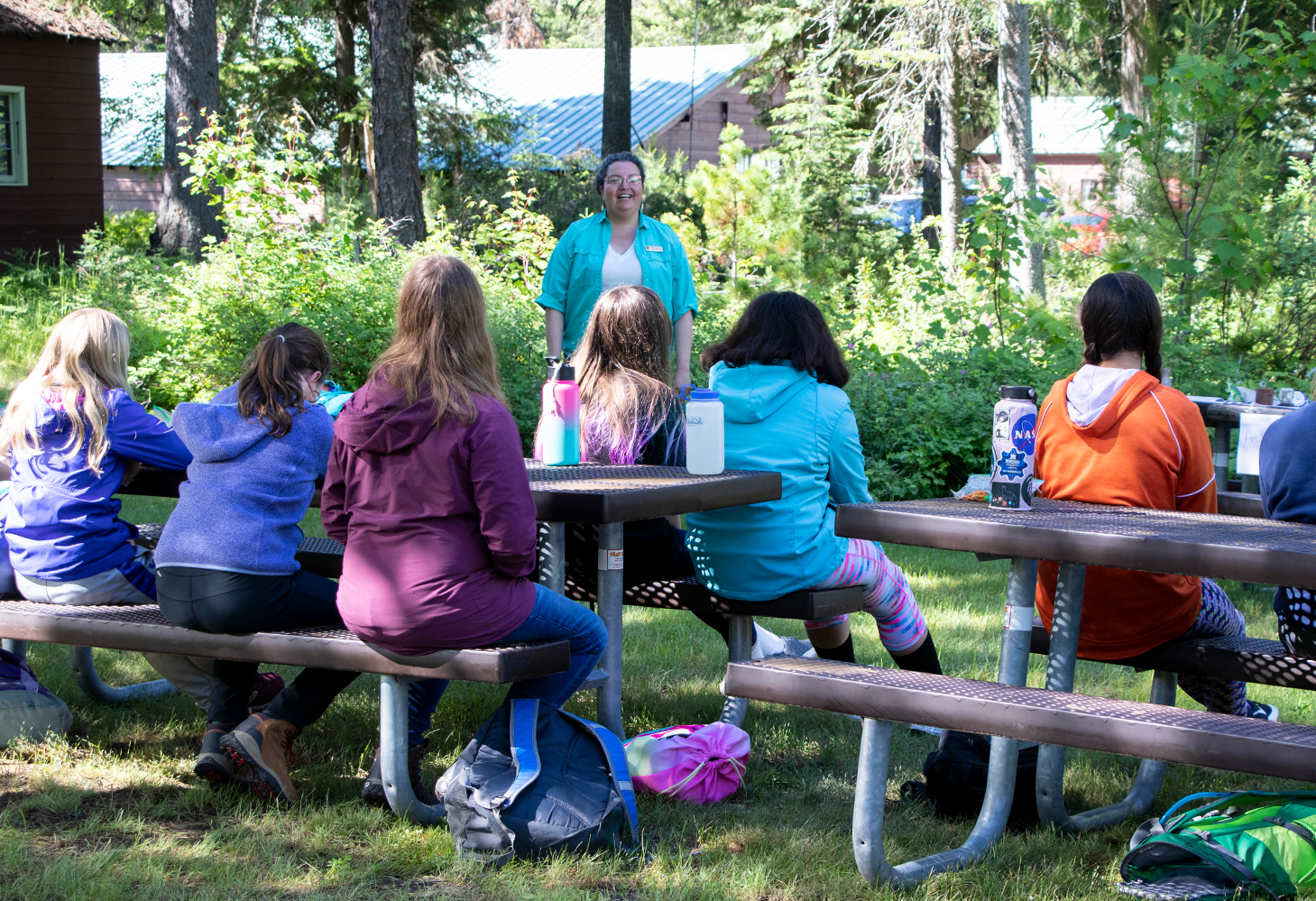 A group of young girls attend the Women In Science Career Fair in Glacier National Park