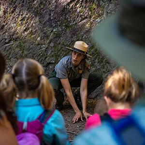 Ranger on trail talking to girls.