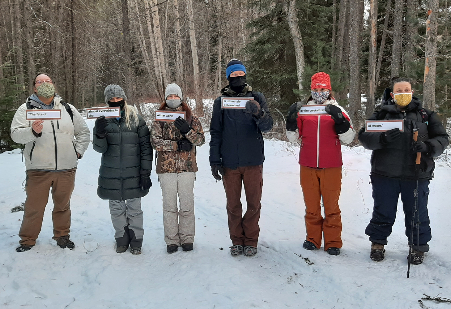 A group of teachers perform an activity outside during the winter session of the workshop Flathead Watershed Through The Seasons