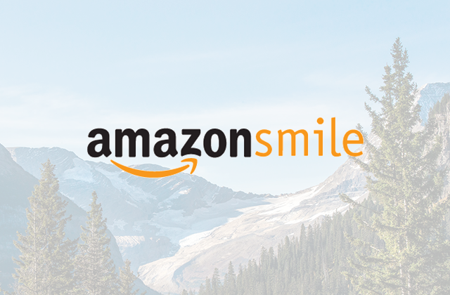 Amazon smile logo with glacier and trees in background.