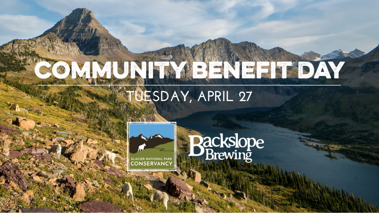 Mountain goats forage along a mountain range above an alpine lake with text that reads Community Benefit Day, Tuesday April 27, Glacier National Park Conservancy and Backslope Brewing